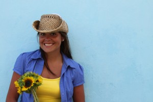 10001-a-beautiful-woman-with-a-hat-holding-a-sunflower-or
