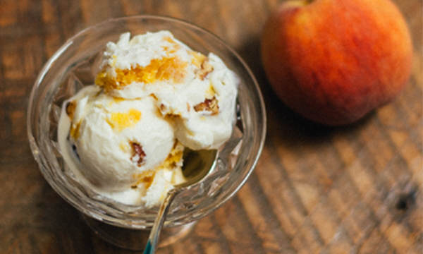 In honor of National Peach Ice Cream Day, try this bourbon peach ice cream recipe. Perfect for a 4th of July dessert.