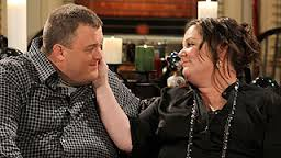 Mike (Billy Gardell) and Molly (McCarthy)