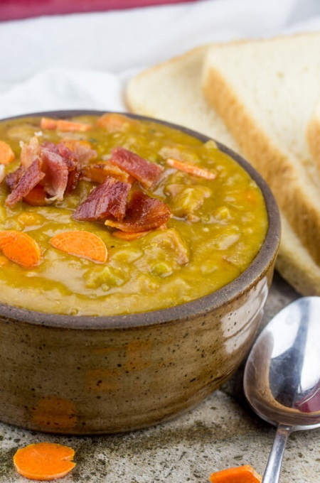 ham and split pea soup full of carrots and topped with chopped bacon